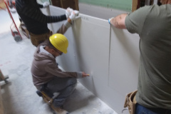 construction-student-cutting-drywall